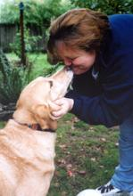 Janet Berwick getting kisses from her dog